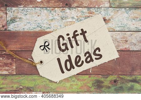 Gift Ideas Message On A Cloth Gift Tag On Weathered Wood