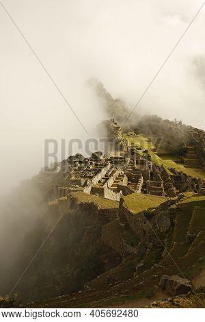 Machu Picchu Revealed From Early Morning Clouds. Urubamba, Peru