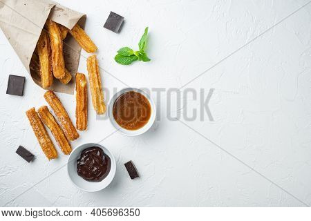 Churros With Caramel, Traditional Spanish Cusine, On White Background, Top View Flat Lay With Space