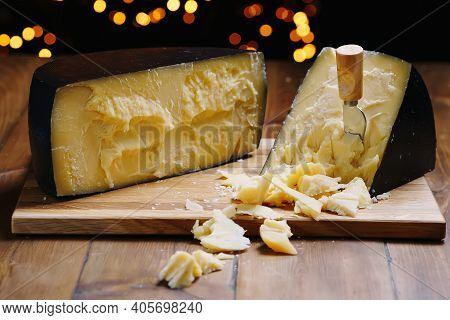 Medium Hard Cheese Head Parmesan On Wooden Board, With Cheese Parmesan Knifes.
