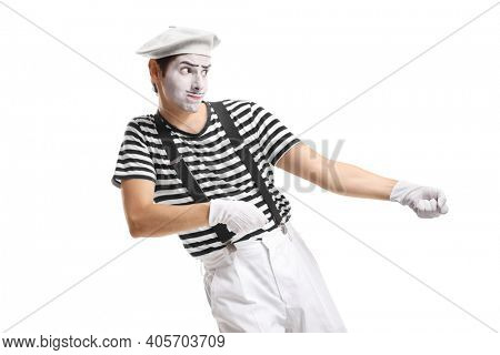 Pantomime man pulling an imaginary rope isolated on white background