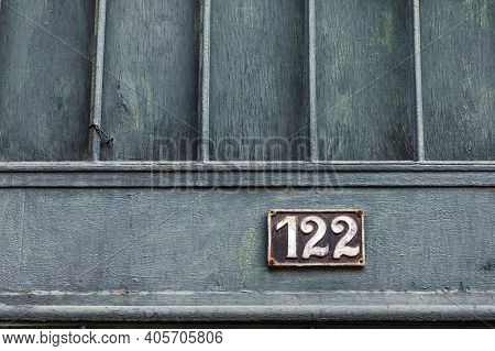 Number 122, The Number Of Houses, Apartments, Streets. The White Number On A Brown Metal Plate, Hous