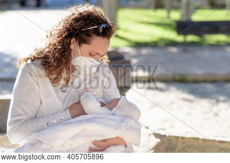 Mother Breastfeeding Her Newborn Baby In Her Arms While Wearing Surgical Face Mask Sick Concept Duri