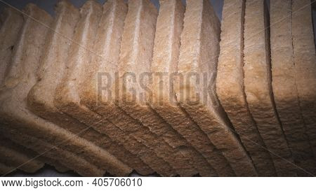 Fresh Bread On Sliced, Wheat Bread. Bread On A Black Background, Fresh Bread, Sliced ​​bread.