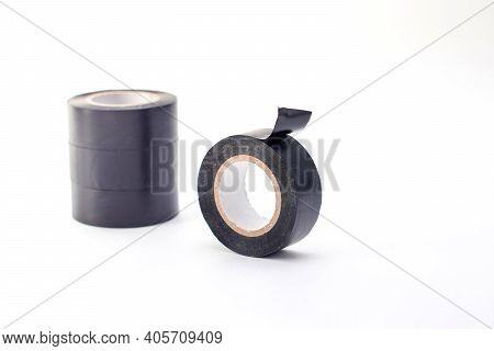 Rolls Of Black Insulating Tape Isolated On A White Background