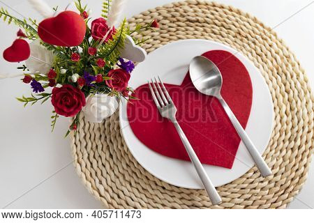 St Valentine's Table Setting With Festive Decorations On A Wicker Stand, With White Plate, A Fork Wi