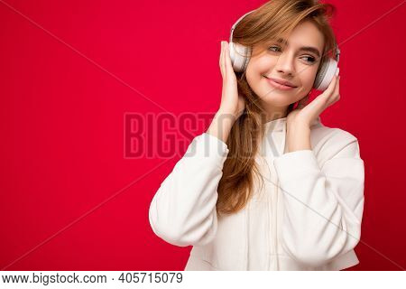 Photo Of Beautiful Happy Smiling Young Blonde Woman Wearing White Hoodie Isolated Over Colourful Bac
