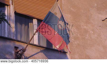 Slovenian Flag Next To Window