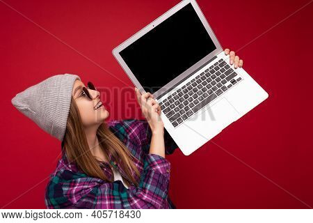 Close-up Portrait Of Overjoyed Beautiful Smiling Happy Young Woman Holding Computer Laptop Looking A