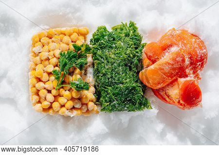 Colorful Frozen Briquettes Of Berries, Greens And Veggies On Ice. Top View.