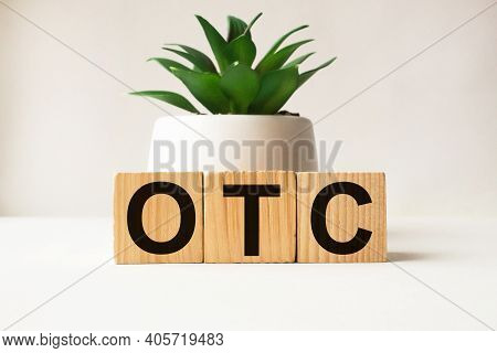 A Word Otc On Wooden Cubes. Business Concept. Business And Finance