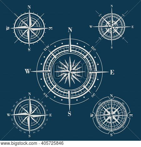 Set Of Compass Roses Or Wind Roses On Blue Background
