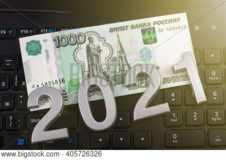 Close-up. Black Background. On It Are Numbers 2021 And A Bill Of 1000 Rubles. Russia.