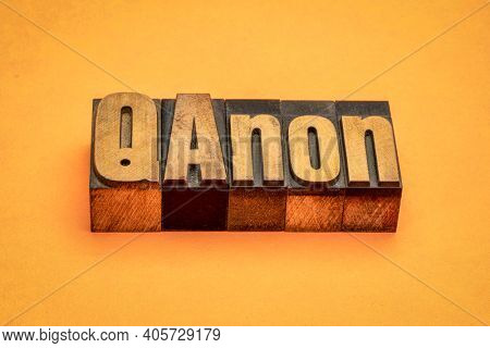 QAnon word abstract in vintage letterpress wood type, disproven and discredited far-right conspiracy theory