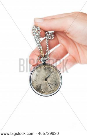 Hand Holding A Retro Styled Pocket Chain Watch