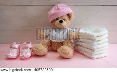 Baby Girl Diapers, Teddy Sitting On Pink Color Floor