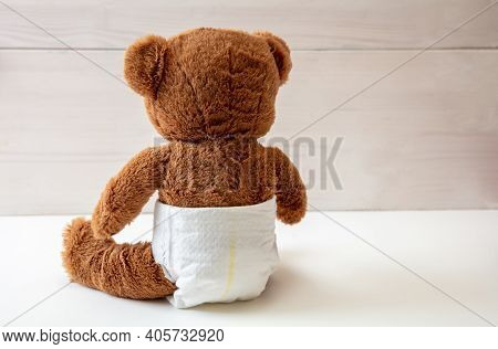 Baby Teddy Wearing Diaper Sitting On White Color Floor