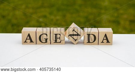 Agenda - Words From Wooden Blocks With Letters, Agenda Item List Concept, Black Mirrored Background