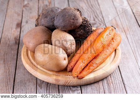 Boiled Vegetables On A Cutting Board. Potatoes, Beets, Carrots. Semi-finished Products
