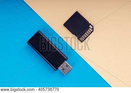 Usb Flash And Sd Memory Card On Blue And Yellow Background. Different Kind Of Portable Storage Devic
