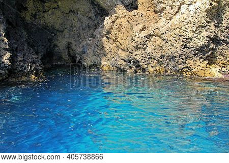 Blue Sea Water, Rocks, A Cave Carved In The Rock, A Cave In The Rocks By The Sea, A Blue Cave In Sic