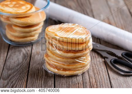 Frozen Pancakes On A Wooden Table. Ready Frozen Food, Healthy Food