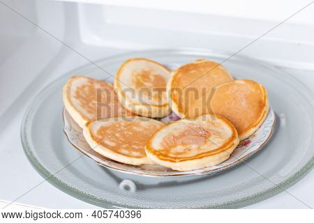 Frozen Pancakes In The Microwave. Ready Frozen Food, Healthy Food