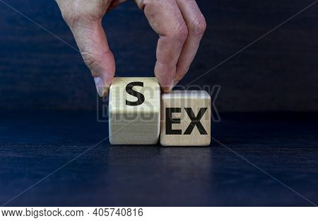Sex With An Ex Symbol. Hand Turns A Cube And Changes The Word 'ex' To 'sex'. Beautiful Dark Grey Bac