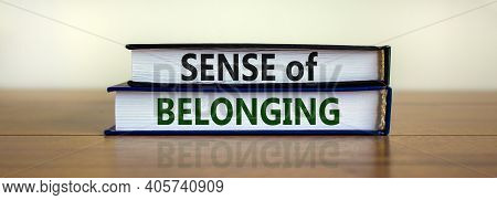 Sense Of Belonging Symbol. Books With Words 'sense Of Belonging' On Beautiful Wooden Table, White Ba