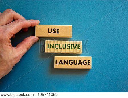 Use Inclusive Language Symbol. Wooden Blocks With Words 'use Inclusive Language'. Beautiful Blue Bac