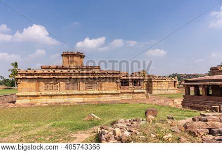 Aihole, Karnataka, India - November 7, 2013: Lad Khan Or Chalukya Shiva Temple Among Other Brown Sto