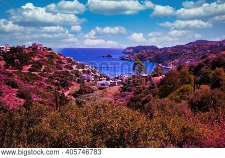 Crete, Greece: A Wide Angle Seascape Near Stalida Beach Of Blue Mediterranean Sea Against Rocky Moun