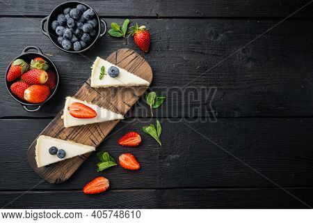 New York Cheesecake Or Classic Cheesecake With Fresh Berrie, On Black Wooden Table Background, Top V