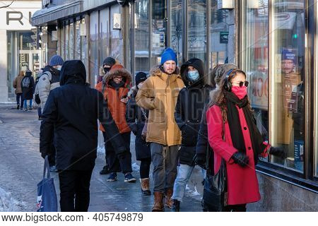 Montreal, Ca - 30 January 2021 : Customers In A Line Outside Of Saq Liquor Store In Montreal