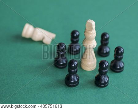 White Piece Falls Into A Trap Of Black Chessmen. Concept Of Deadlock, Hopeless Situation, Despair