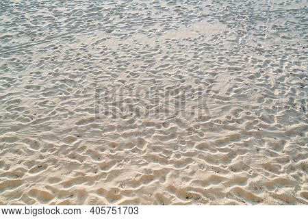 Top View Of Sandy Beach.background With Copy Space And Visible Dirty Sand Texture.