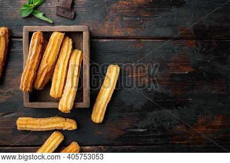 Churros With Chocolate, Traditional Spanish Cusine, On Old Dark  Wooden Table Background, Top View F