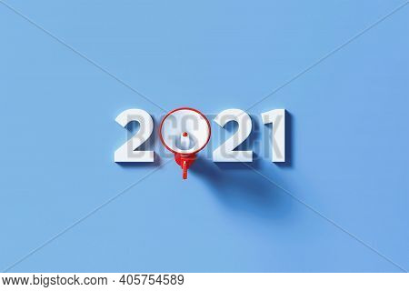 Red Megaphone Forming 2021 Text On Blue Background. Horizontal Composition With Copy Space. Great Us