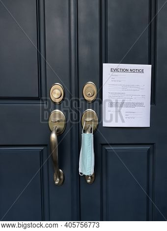 Home Front Door With Eviction Notice And Facemask For Renter In Default During Covid 19 Pandemic