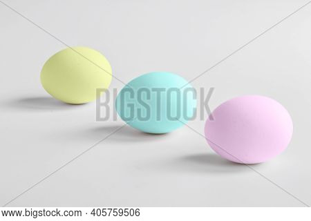 Eggs Painted In Pastel Colors On A Light Background With Shadows. Minimalism. Copy Space. Front View