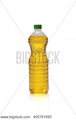 Golden Yellow Oil In A Bottle On A White Background