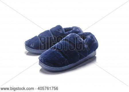Soft Shoes With Blue Fur To Keep You Warm On A White Background.