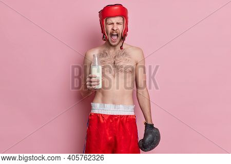 Emotional Topless Male Boxer Shouts Loudly Keeps Mouth Opened Holds Glass Bottle Of Milk Wears Hat S