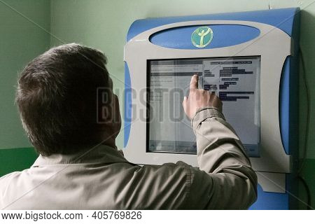 Lutsk, Volyn / Ukraine - April 13 2009: Unemployed Man Posing Next To The Digital Display Screen At