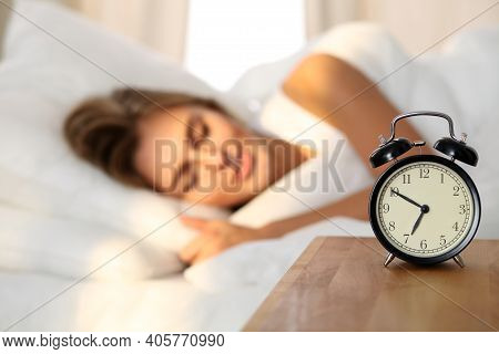 Beautiful Young Woman Sleeping And Smiling While Lying In Bed Comfortably And Blissfully On The Back