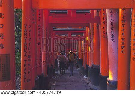 Kyoto,japan - Dec 5 : Unidentified People Walk Along The Famous Red Tori Gate In Fushimi Inari Shrin