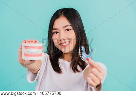 Portrait Young Asian Beautiful Woman Smiling Holding Silicone Orthodontic Retainers For Teeth Retain