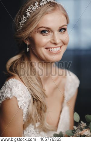 Pretty Bride With Wedding Makeup, Fashion Jewelry. Beautiful Woman Posing In White Wedding Dress. We