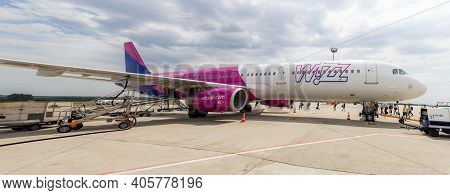 Budapest Airport, Hungary: May18, 2019: Airbus A320 Wizz Air With Attached Passenger Boarding Stairs
