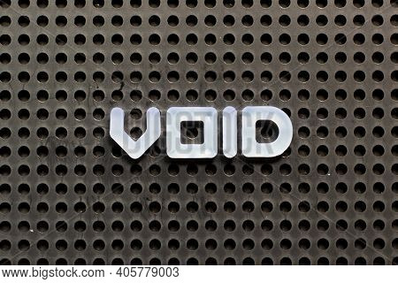 White Color Letter In Word Void On Black Pegboard Background